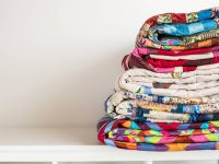 stack of folded quilts