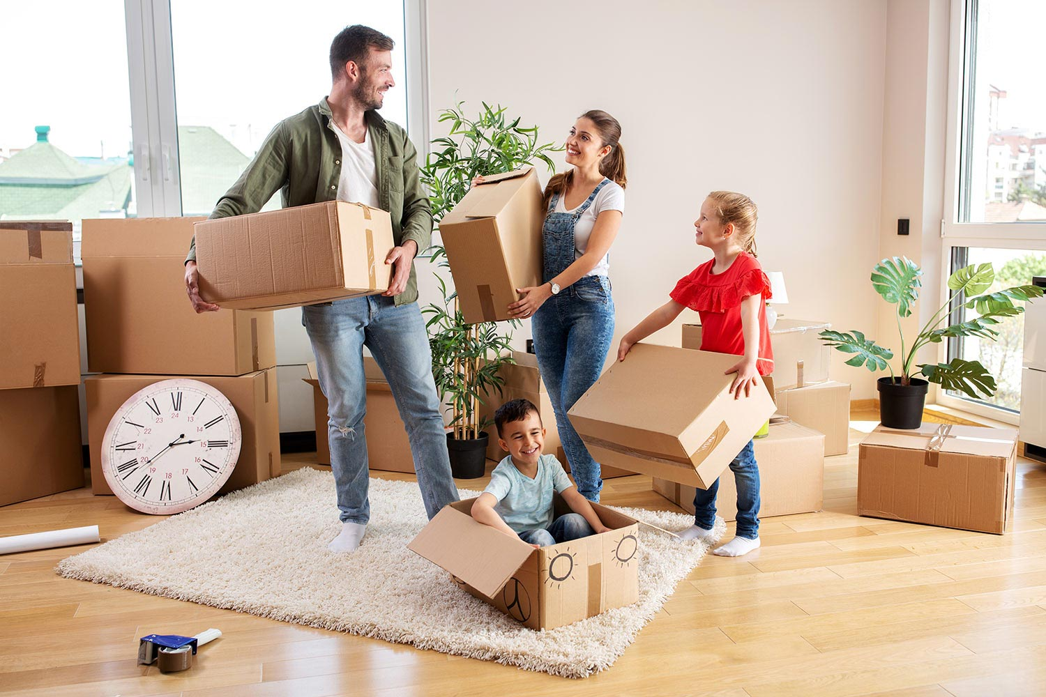 a family packing for a move to another state with their children