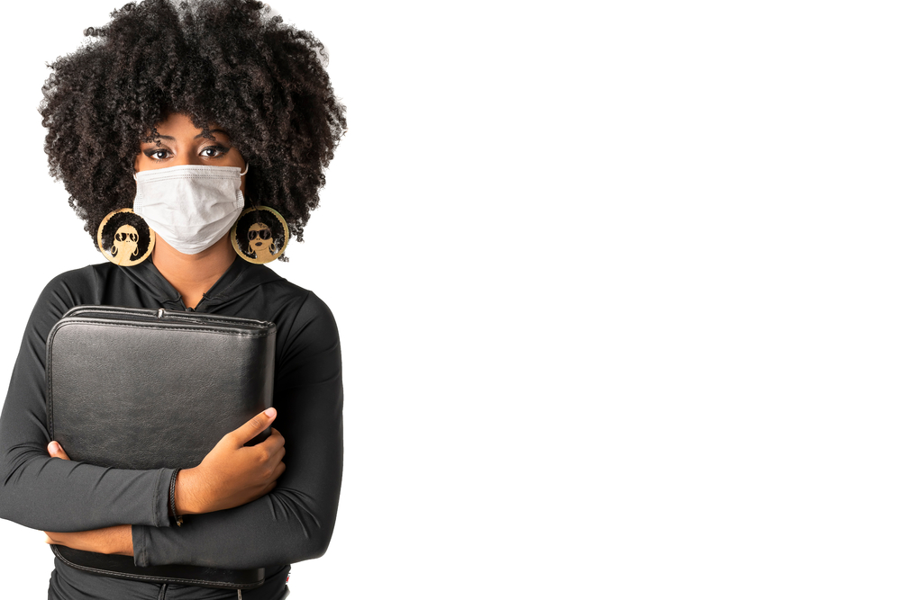 young student with covid-19 medical mask protective against coronavirus photographed in white background