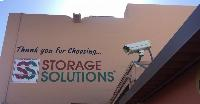 Sun City Storage Solutions Exit Mural and Security Camera